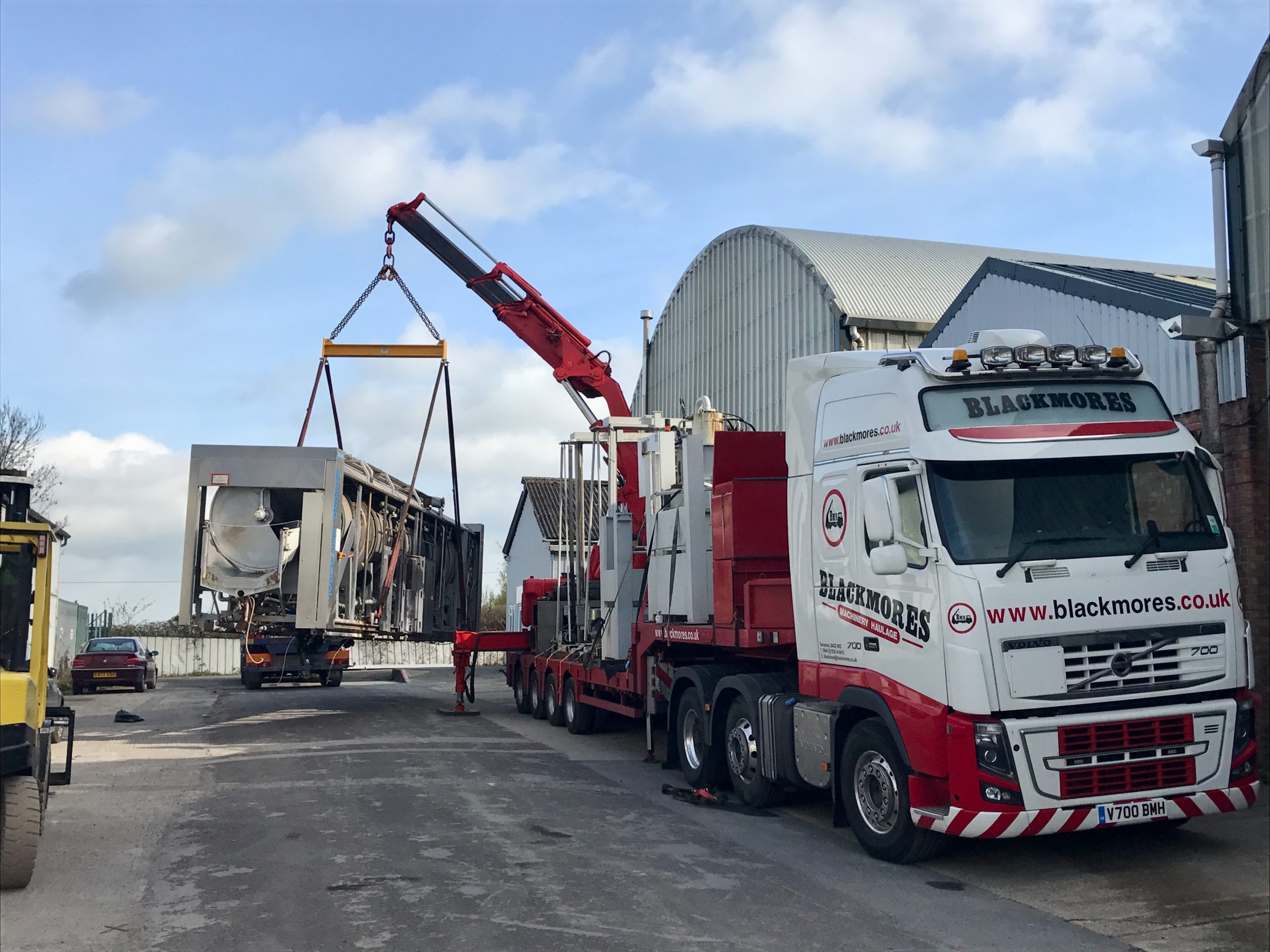 Track with crane lifting heavy load